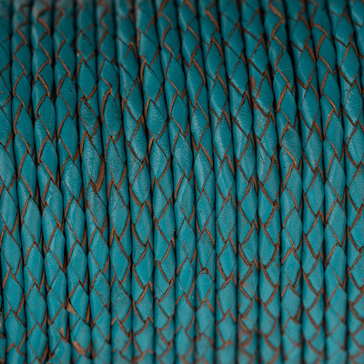 Lederband rund geflochten, 100cm, 6mm, CAPRIBLAU mit Naturkanten