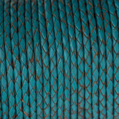 Lederband rund geflochten, 100cm, 4mm, CAPRIBLAU mit Naturkanten